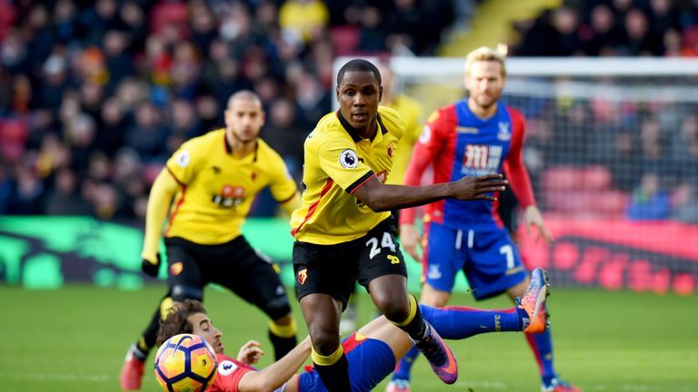 Odion Ighalo of Watford evades a challenge from Mathieu Flamini of Crystal Palace