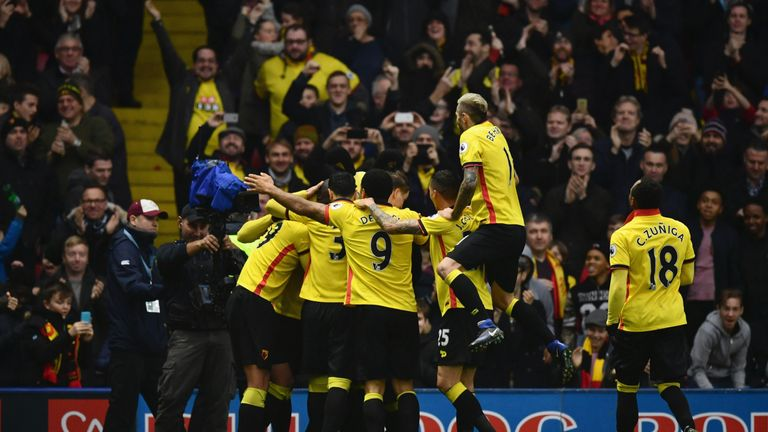 Stefano Okaka is mobbed after scoring Watford's third against Everton