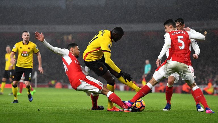 M'Baye Niang (C) competes for the ball against Francis Coquelin (L) and Gabriel (R)