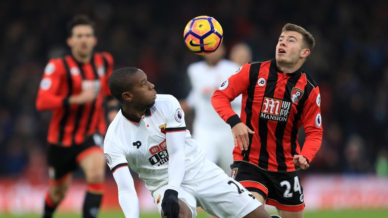 Kabasele of Watford (L) and Ryan Fraser of AFC Bournemouth (R) battle for possession