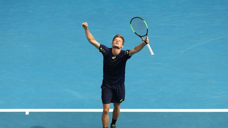 David Goffin celebrates winning his fourth-round match against Dominic Thiem