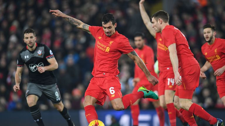 Liverpool defender Dejan Lovren (centre) strikes the ball, but is unable to trouble Fraser Forster