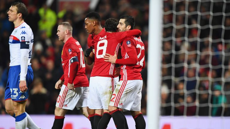 Henrikh Mkhitaryan is congratulated by team-mates after scoring United's third