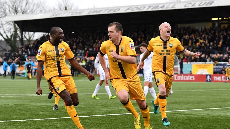 Jamie Collins (C) celebrates scoring the only goal in Sutton's victory over Leeds in the previous round