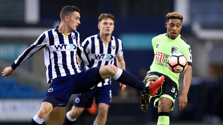Millwall's Ben Thompson (L) and AFC Bournemouth's Jordon Ibe battle for the ball