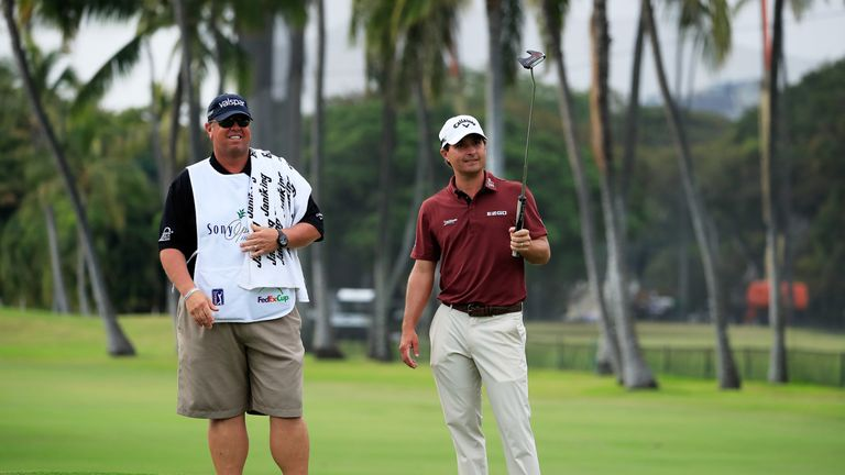 Kisner and his caddie Duane Bock see the funny side after he mis-read his eagle putt