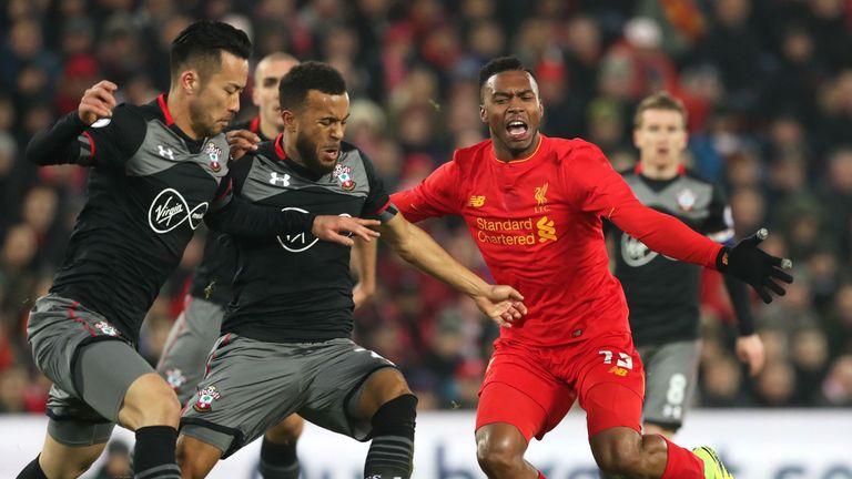 Ryan Bertrand challenges Daniel Sturridge of Liverpool