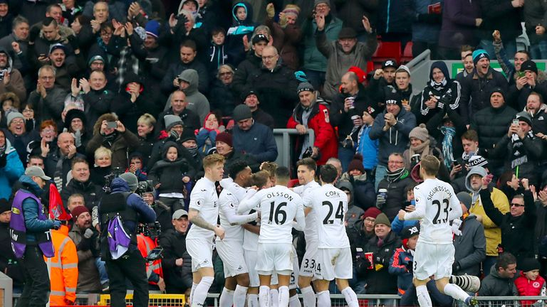 Fernando Llorente is mobbed after opening the scoring at Anfield