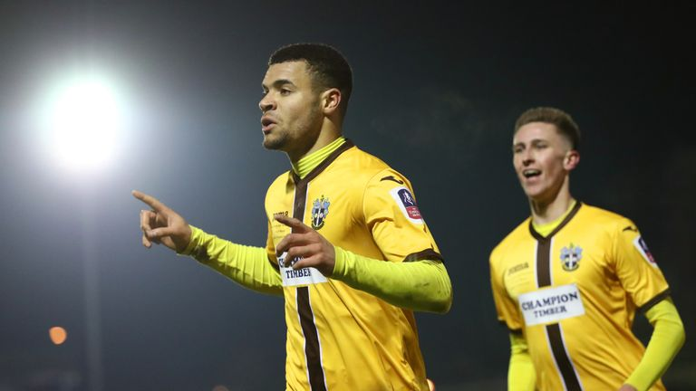 Maxime Biamou of Sutton United celebrates scoring his side's second goal