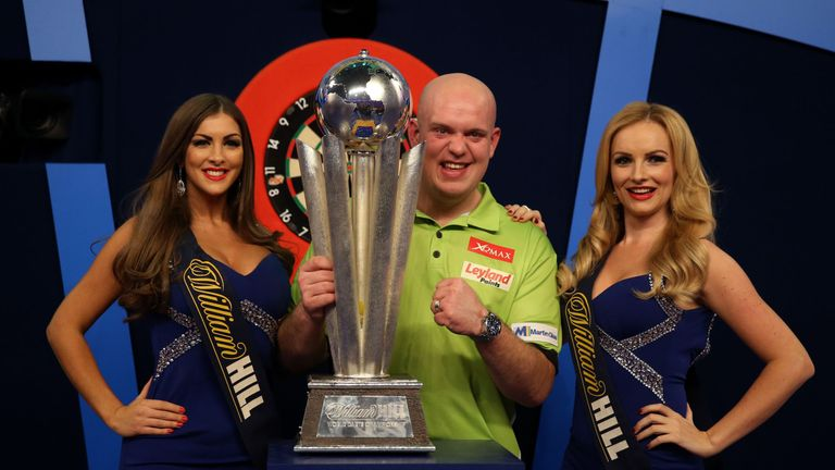 Michael van Gerwen celebrates with the Sid Waddell trophy