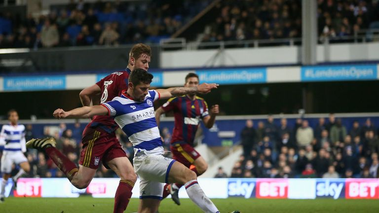 Pawel Wszolek squeezes home the winner for QPR