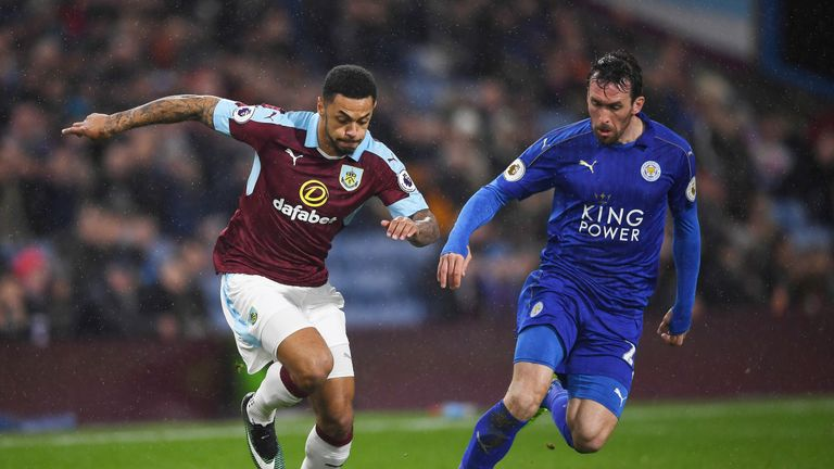 Andre Gray and Christian Fuchs compete for the ball