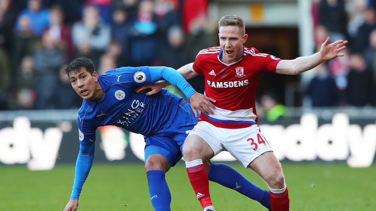 Leonardo Ulloa and Adam Forshaw battle for possession at the Riverside