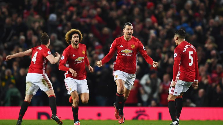 Zlatan Ibrahimovic celebrates after scoring his 14th league goal this season to equalise against Liverpool on Sunday