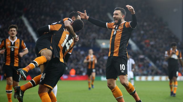 Robert Snodgrass of Hull City (right) celebrates scoring his side's first goal with his Hull City team mates