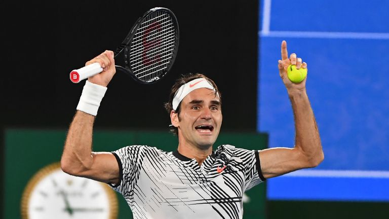 Federer celebrates after clinching his 18th Grand Slam title
