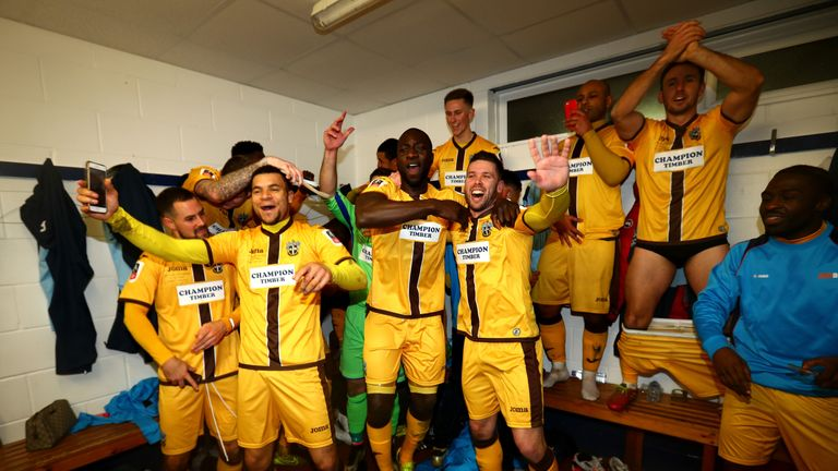 Sutton United players celebrate after the game