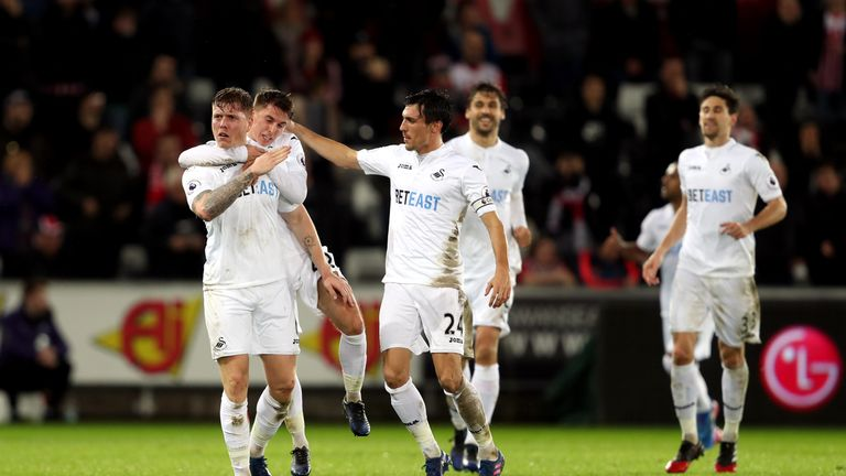 Swansea City's Alfie Mawson (centre) celebrates scoring his side's first goal of the game