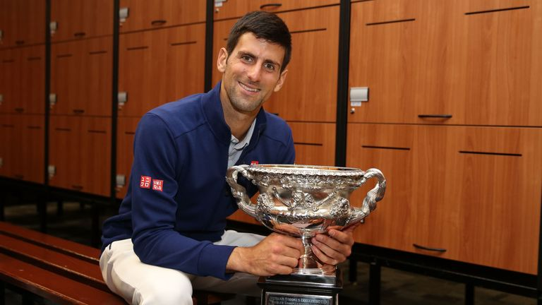 Djokovic poses with the Norman Brookes Challenge Cup