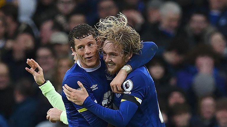 Davies celebrates Ross Barkley after scoring Everton's third goal