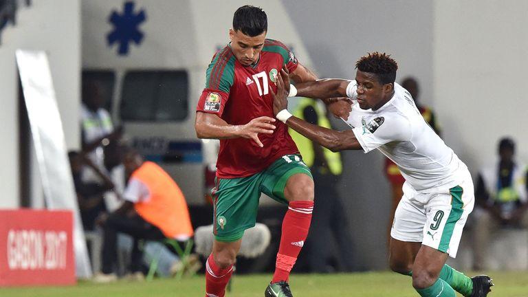 Ivory Coast forward Wilfried Zaha (R) challenges Morocco midfielder Nabil Dirar