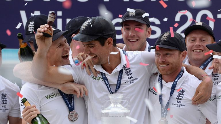 Cook holds aloft the Ashes urn at the end of the series