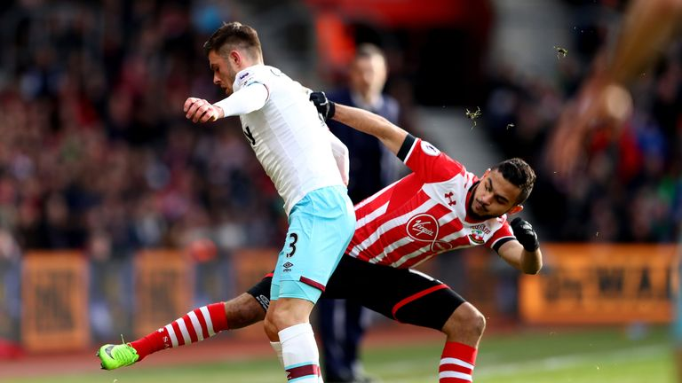 Aaron Cresswell is tackled by Sofiane Boufal