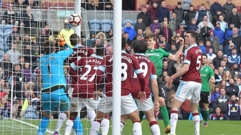 Sean Raggett (centre) heads past Tom Heaton in the 89th-minute at Turf Moor