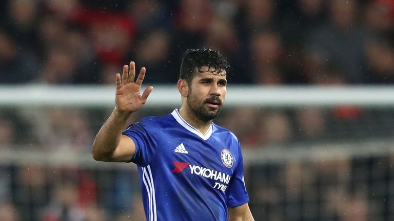 Diego Costa waves to the travelling Chelsea fans after the 1-1 draw at Liverpool
