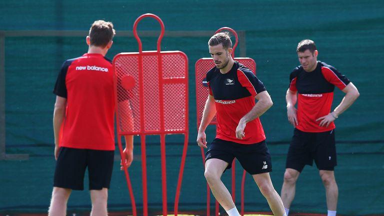 Jordan Henderson (centre) should be back for the start of the season