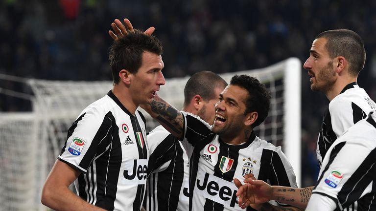 Alves celebrates with his Juventus team-mates