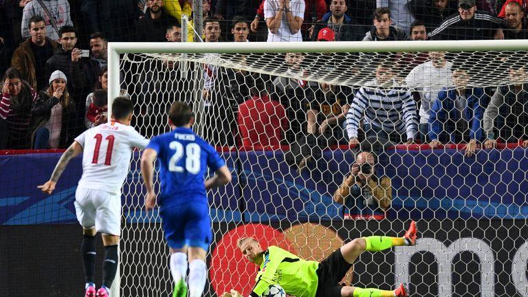 Kasper Schmeichel saves a penalty from Correa