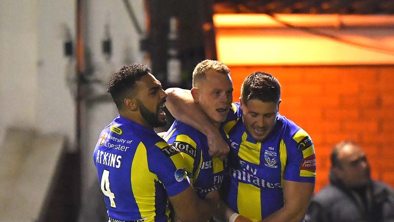Warrington Wolves' Kevin Brown is congratulated on scoring his team's opening try