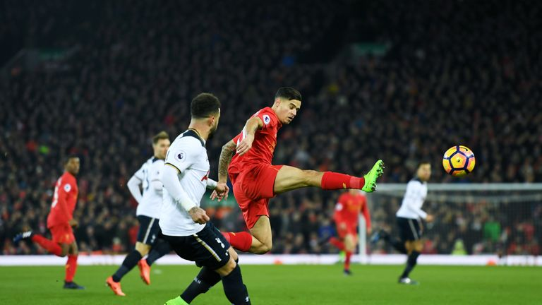 Philippe Coutinho (right) flicks the ball on against Tottenham