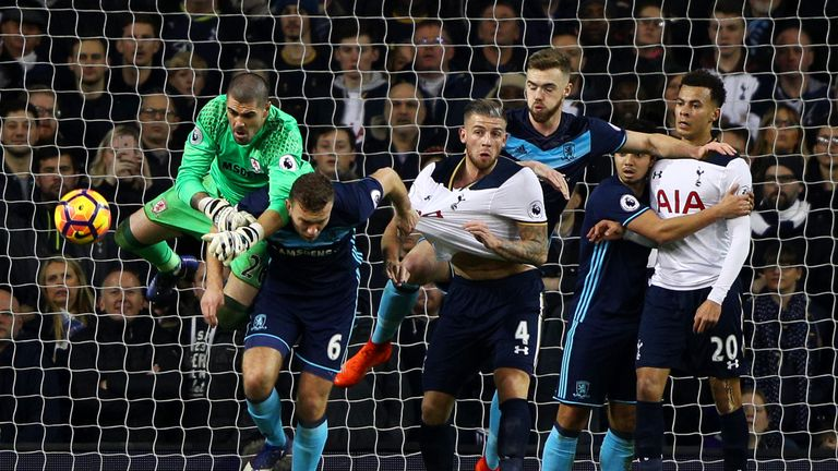 Victor Valdes attempts to punch clear as Calum Chambers tangles with Toby Alderweireld