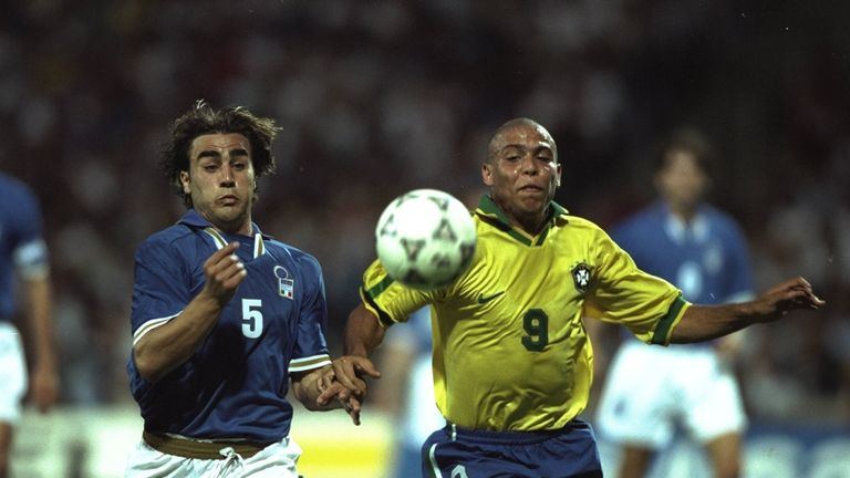 Cannavaro battling with Brazil legend Ronaldo (R) in 1997