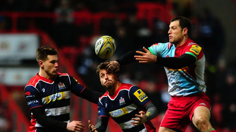 Jack Wallace contests a high ball with Harlequins wing Tim Visser