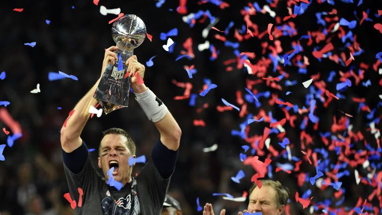 Tom Brady holds the Vince Lombardi Trophy aloft for the New England Patriots