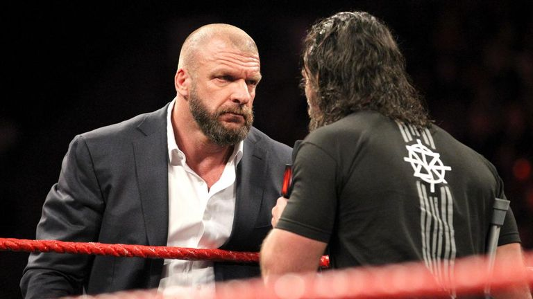Triple H stares down rival Seth Rollins on Raw