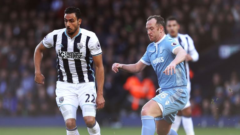 Nacer Chadli (left) and Charlie Adam compete for the ball