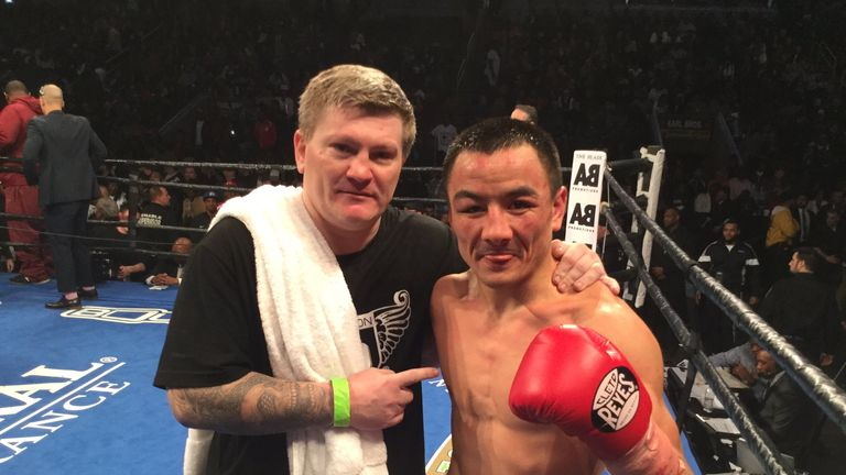 Zhanat Zhakiyanov celebrates with trainer Ricky Hatton after winning the WBA bantamweight title. Picture from @HitmanHatton