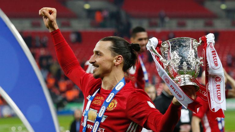 Zlatan Ibrahimovic celebrates with the EFL Cup at Wembley