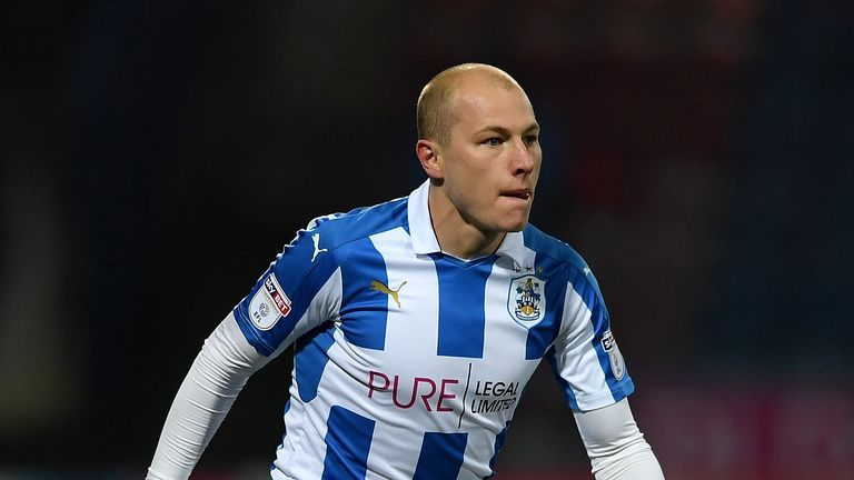Aaron Mooy converted his spot-kick to pull one back for Huddersfield