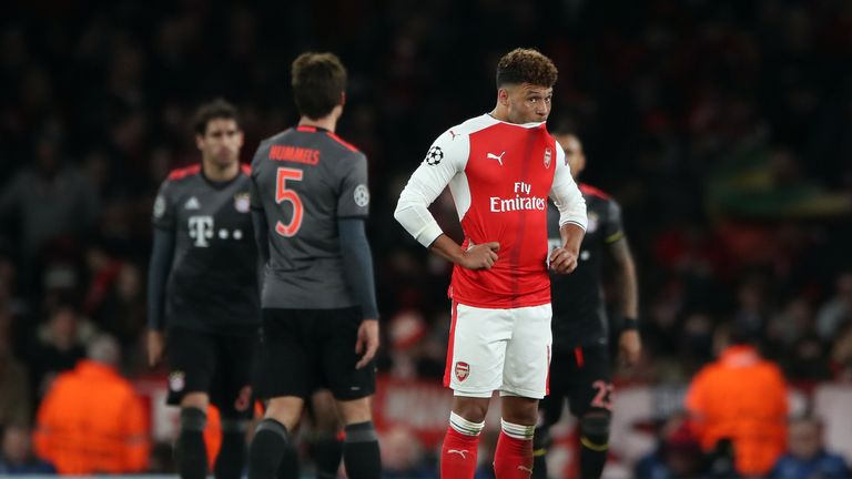 Alex Oxlade-Chamberlain looks dejected after another Champions League humiliation for Arsenal