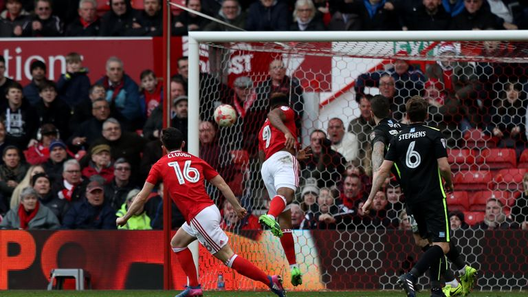 Zach Clough (16) fires Forest ahead