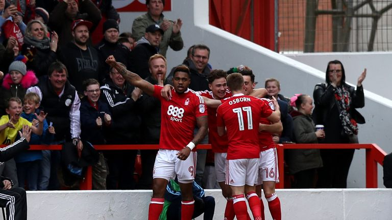 Britt Assombalonga (left) celebrates Nottingham Forest's first goal