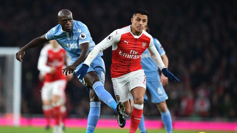 Stoke's Bruno Martins Indi (L) vies with Arsenal's Alexis Sanchez
