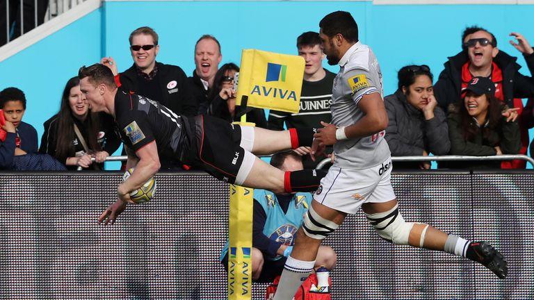 Chris Ashton dives over for a try