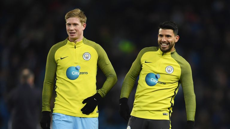 Kevin De Bruyne warms up with team-mate Aguero