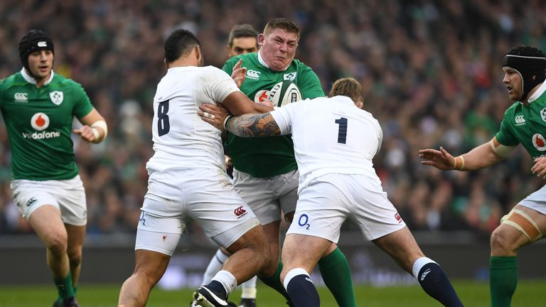Tadhg Furlong of Ireland is tackled by Billy Vunipola and Joe Marler